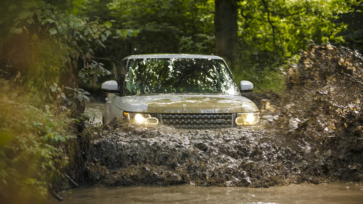 Range Rover driving through muddy water